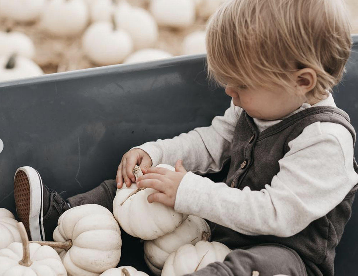 Boy and White Pumpkins