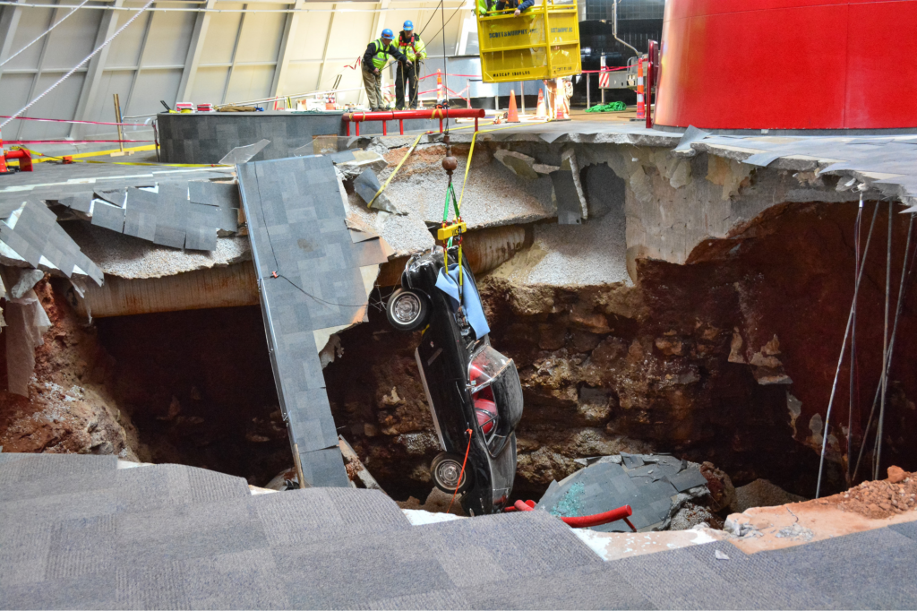 A crane is used to remove the black 1962 Chevrolet Corvette from the sinkhole at the National Corvette Museum on Tuesday 4 March 2014 in Bowling Green, Kentucky.