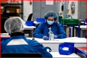 AutoInformed.com on GM Canada Workers assemble masks using ultrasonic welding stations