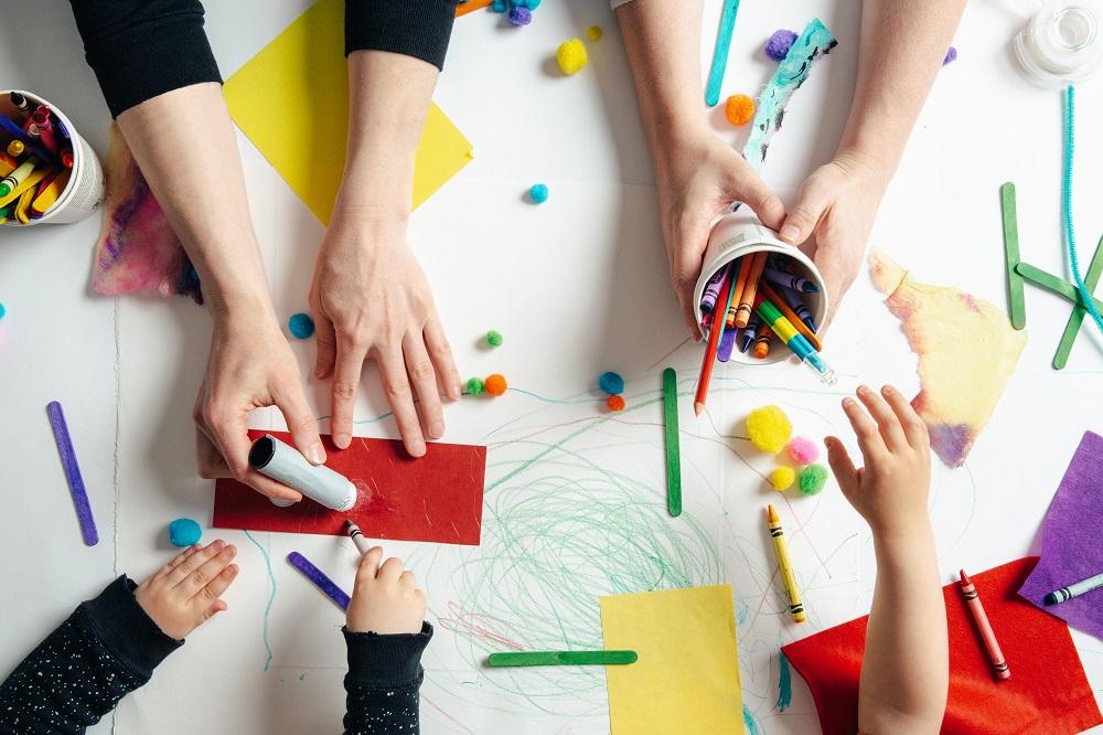 preschool teacher making crafts with kids
