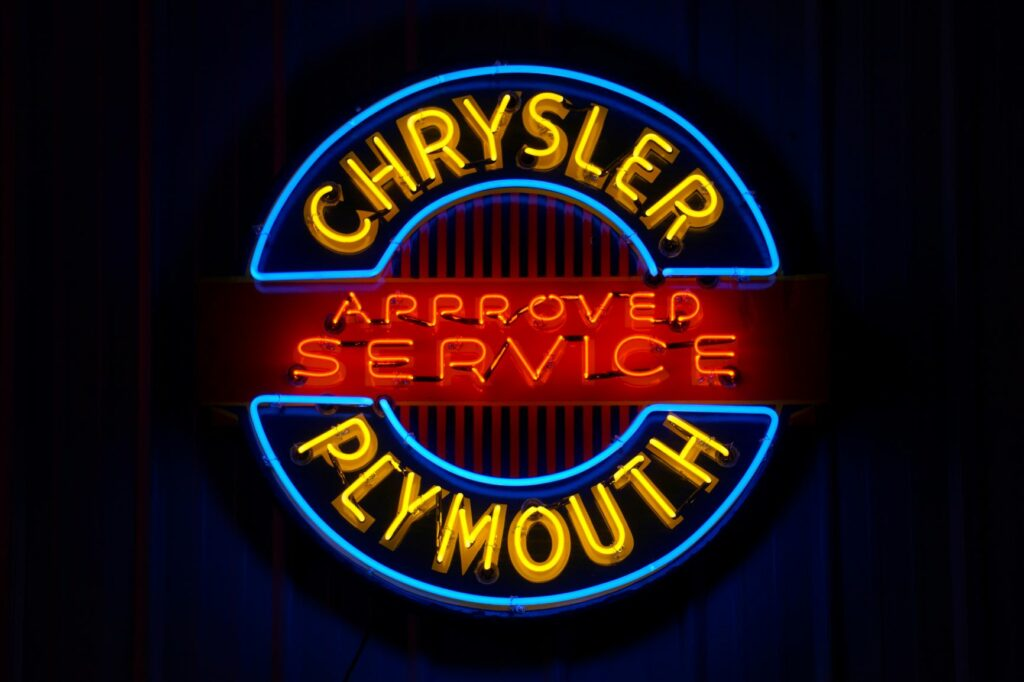 Chrysler Plymouth Approved Service lighted blue, red and yellow neon sign.