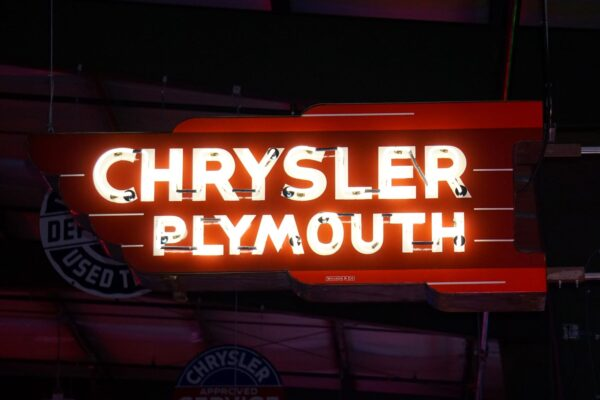 Lighted Chrysler Plymouth red and white neon sign.