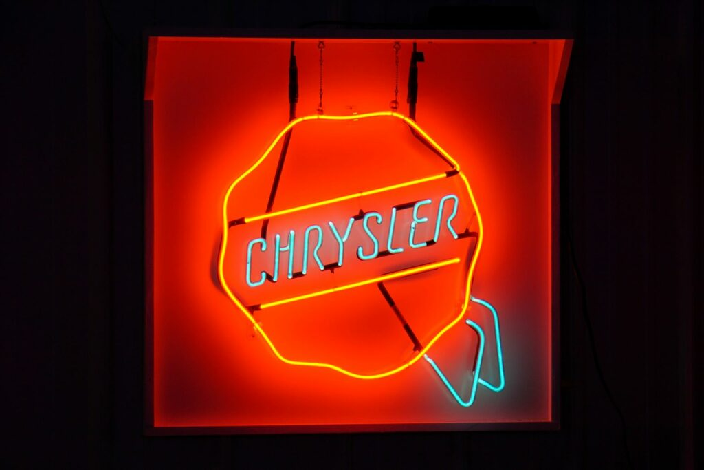 Red and blue lighted Chrysler neon sign.