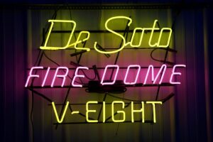 Lighted DeSoto Firedome V-Eight yellow and pink neon sign.