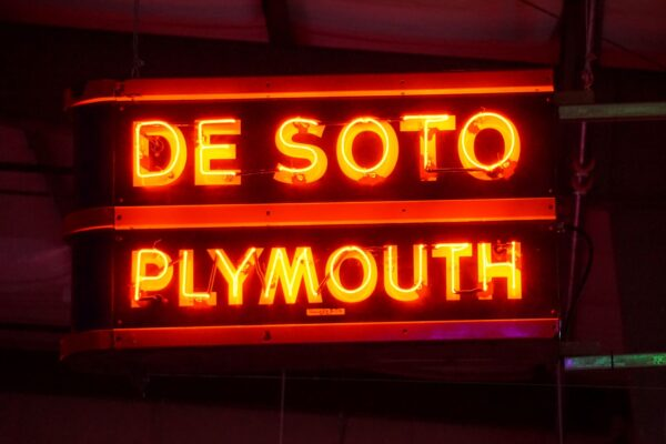 Lighted DeSoto Plymouth orange neon sign.