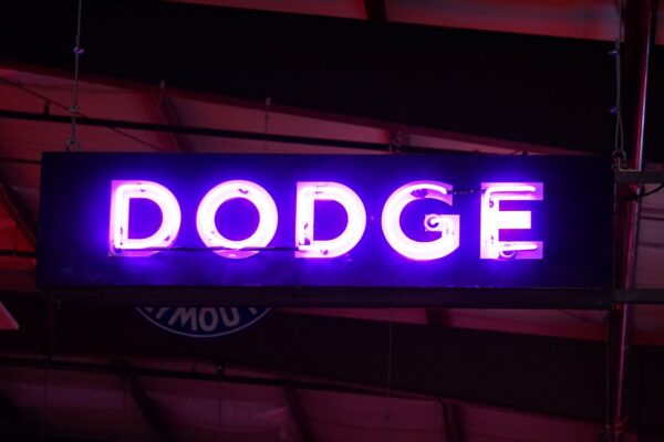 Lighted Dodge horizontal blue and white neon sign.