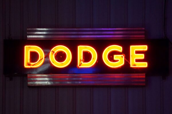 Lighted Dodge horizontal orange and blue neon sign.