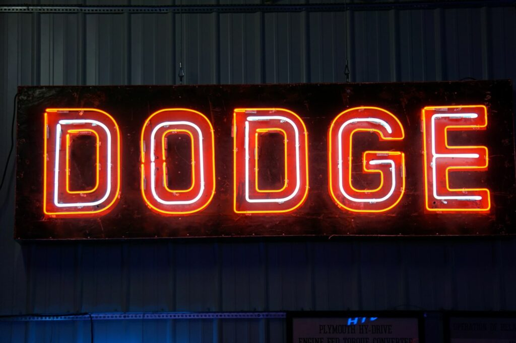 Lighted Dodge horizontal red and white neon sign.