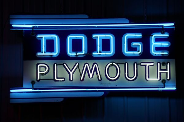 Lighted Dodge Plymouth horizontal blue and white neon sign.
