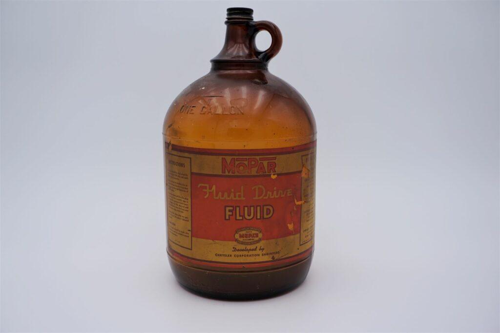 Antique Mopar Fluid Drive Fluid, 1 gallon glass bottle.