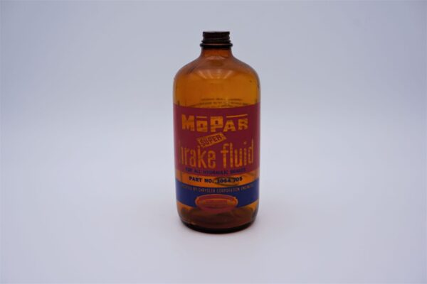 Antique Mopar Super Brake Fluid, 32 oz brown glass bottle.