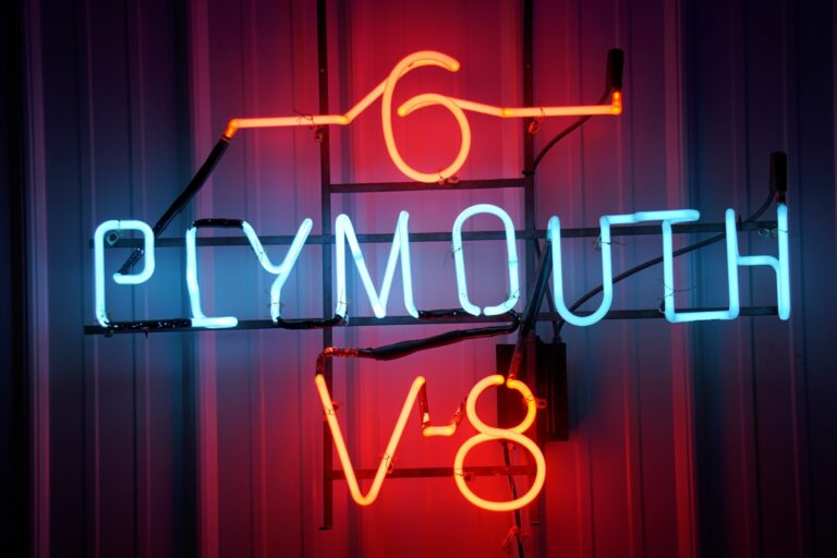 Lighted Plymouth 6 V8 red and blue neon sign.
