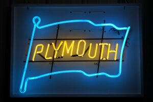 Lighted Plymouth blue and yellow flag neon sign.