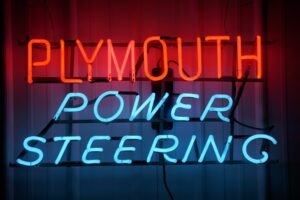 Lighted Plymouth Power Steering red and blue neon sign.