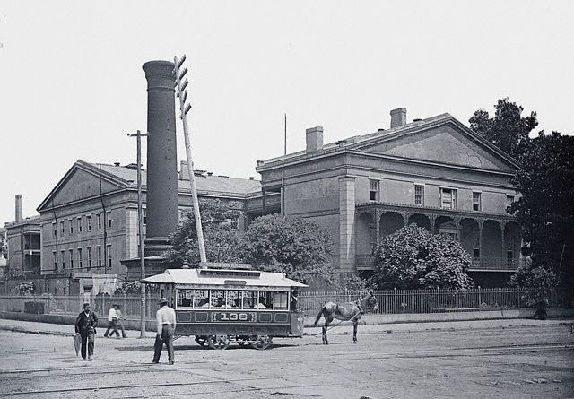 Sreetcar pulled by mule in front of U.S. Mint Building in 1890s. Commons.Wikimedia.org