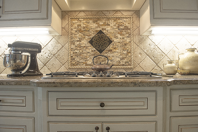 Custom cabinetry, custom tile backsplash, and granite counter.
