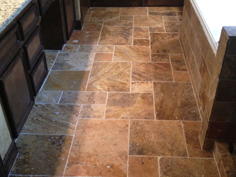 Custom designed Travertine tile floor in bathroom.