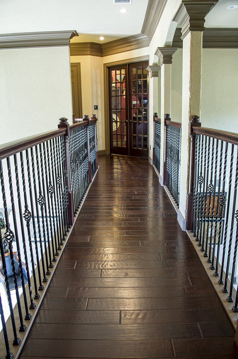 Hand scraped wood in an upstairs walkway.