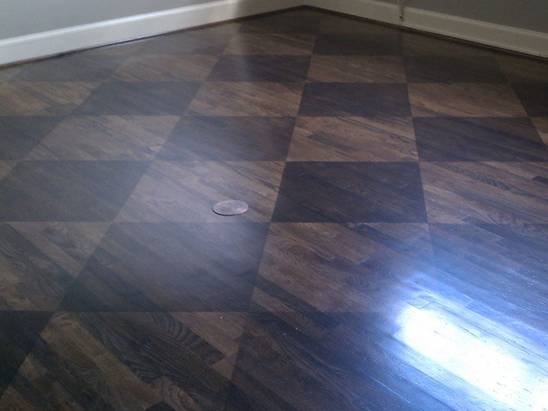 Custom stained wood flooring at a home in The Woodlands.