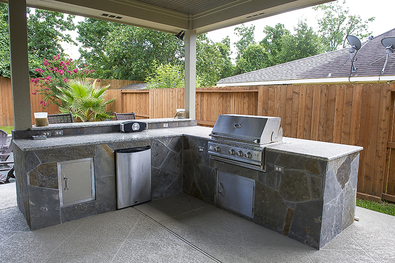 An outdoor kitchen can provide a beautiful space outside for socializing with friends or watching the kids play in the pool.