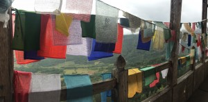 Prayer flags are blown by the wind spreading the good will and compassion.