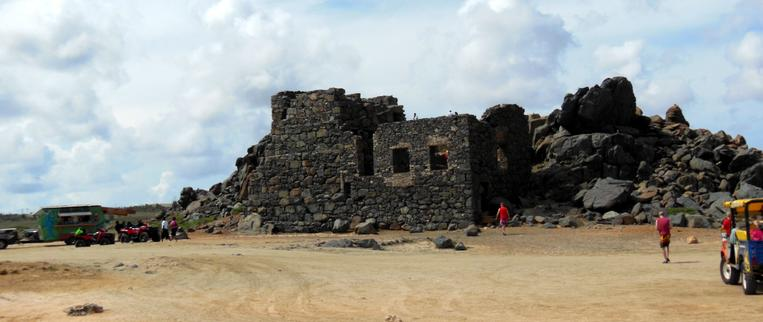 "Bushiribana Gold Mill Ruins - Aruba had couple of gold mills processing gold in the 19th century. Aruba got its name from ""Ora Ruba"" means ""Red Gold"". Shown here is the Bushiribana Gold Mill Ruins. The Gold Mill was shaped in a fortress look-alike to ward off Pirates in these parts. ​"