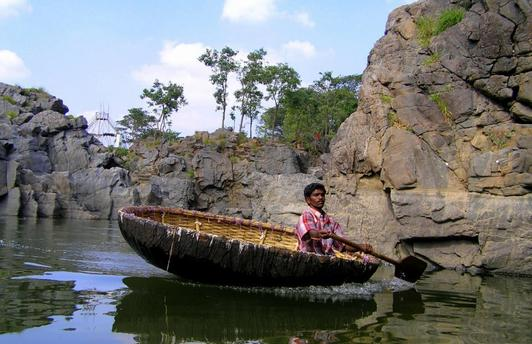 Indian Coracle called Parisal in Tamil Language with the boatman