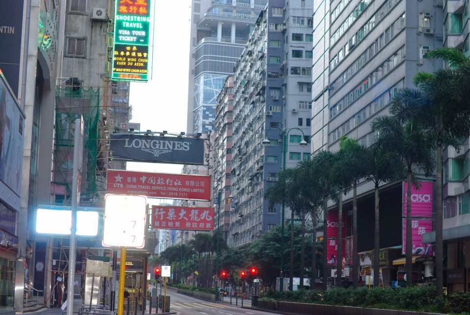 A view of Nathan Road with the ChungKing Mansions Entrance hidden partially on the right