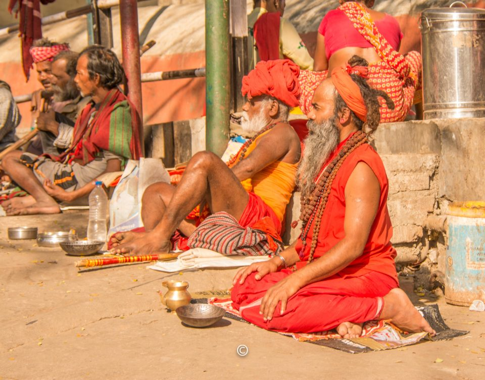 Swamis begging for alms outside the temple
