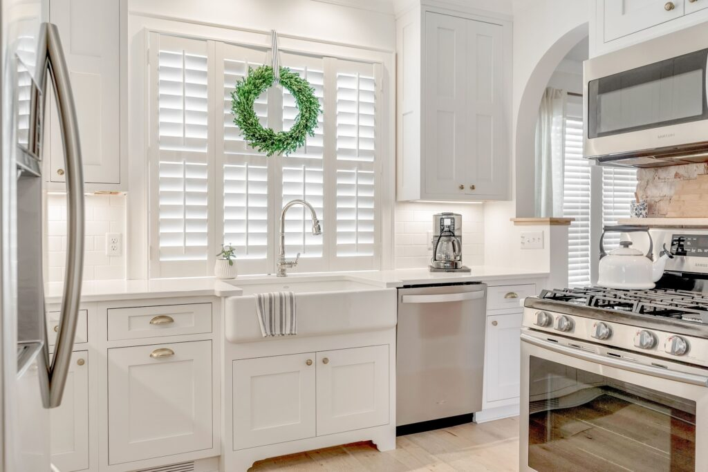 Kitchen with farmhouse sink and plantation shutters