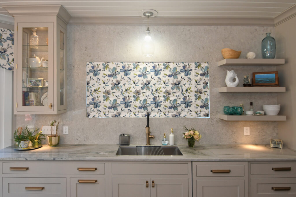 Motorized window shade above the sink