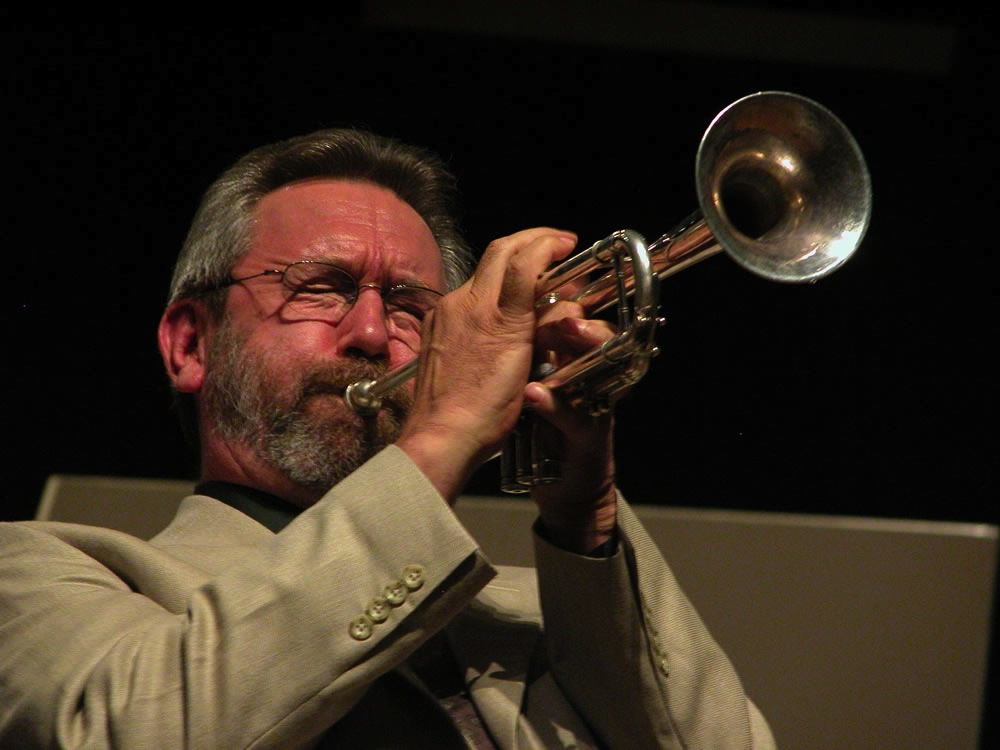 Carl Saunders playing his trumpet in concert.