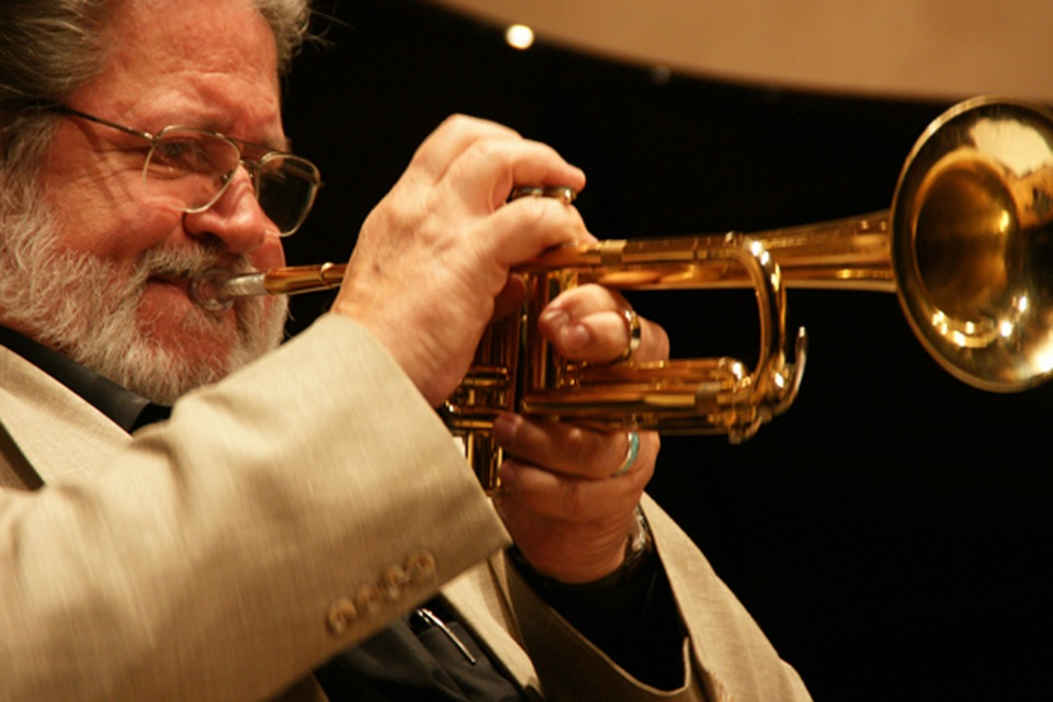 Bobby Shew playing trumpet in concert.