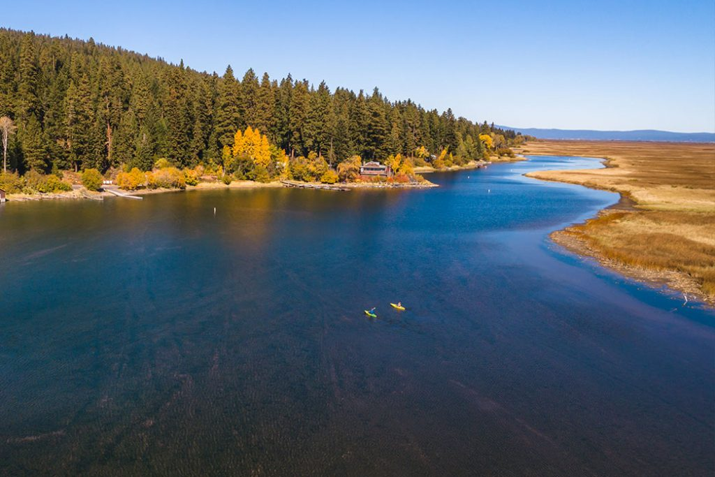 Couple paddling in kayaks on the Upper Klamath Canoe Trail located in Rocky Point, just outside Klamath Falls, Oregon.