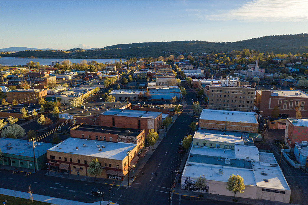 Downtown Klamath Falls with many historic buildings and Lake Ewauna and Mount Shasta in the background.