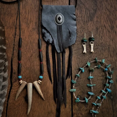 Hand constructed artisan jewelry using natural stones, bones, leather, and sterling silver, with a selection of hand sewn leather purses & medicine bags.