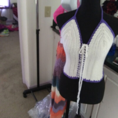 Crocheted hats, ponchos, shawls, skirts, and tops. Beaded ornaments.
