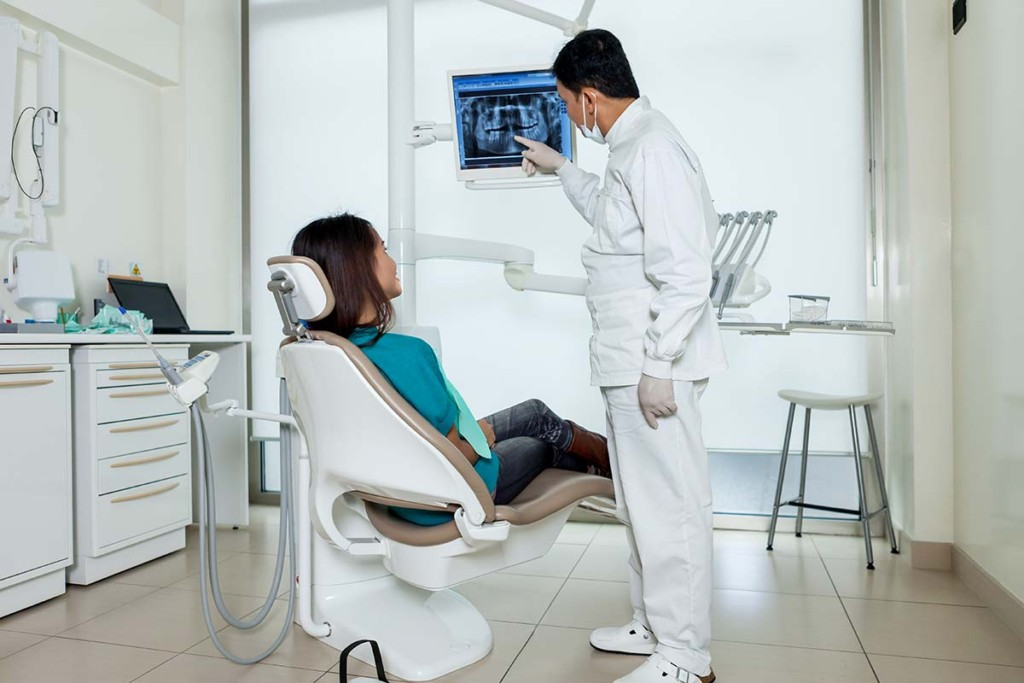 Dentist Is Showing X Ray In Mobile Dental Facility