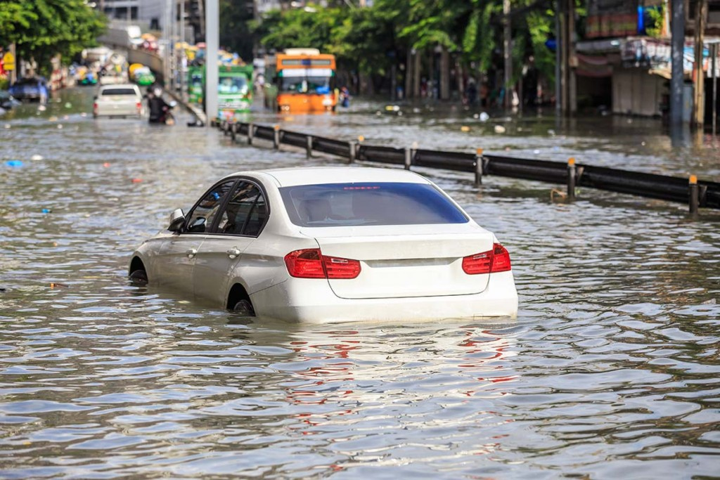 Car On The Street With Water Flooding After Hurricane