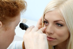 Woman Having Her Eyes Examined By Eye Doctor Inside Mobile Ophthalmology Unit
