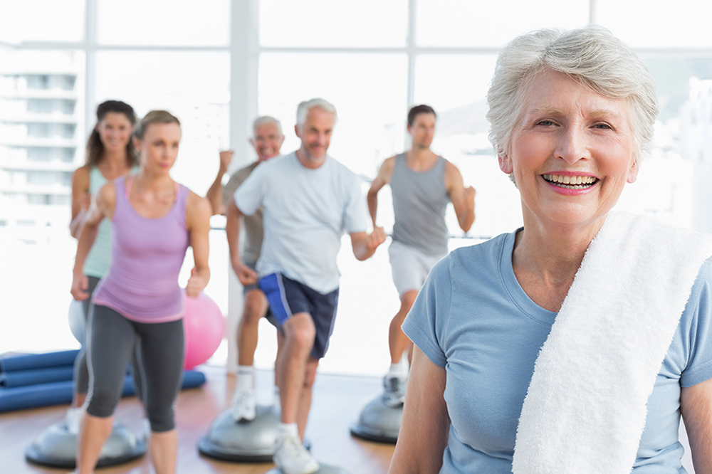 Fit senior woman exercising free of pain- manual sports and orthopedic physical therapy
