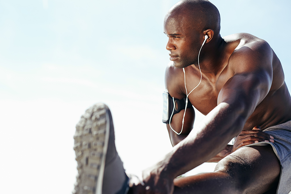 Man performing orthopedic and sports physical therapy stretches