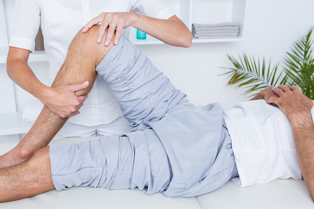 Man having manual orthopedic and sports physical therapy