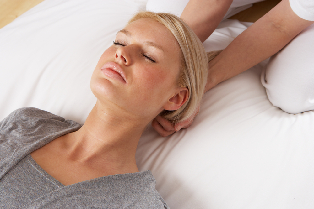 Woman receiving Craniosacral therapy a physical therapy treatment
