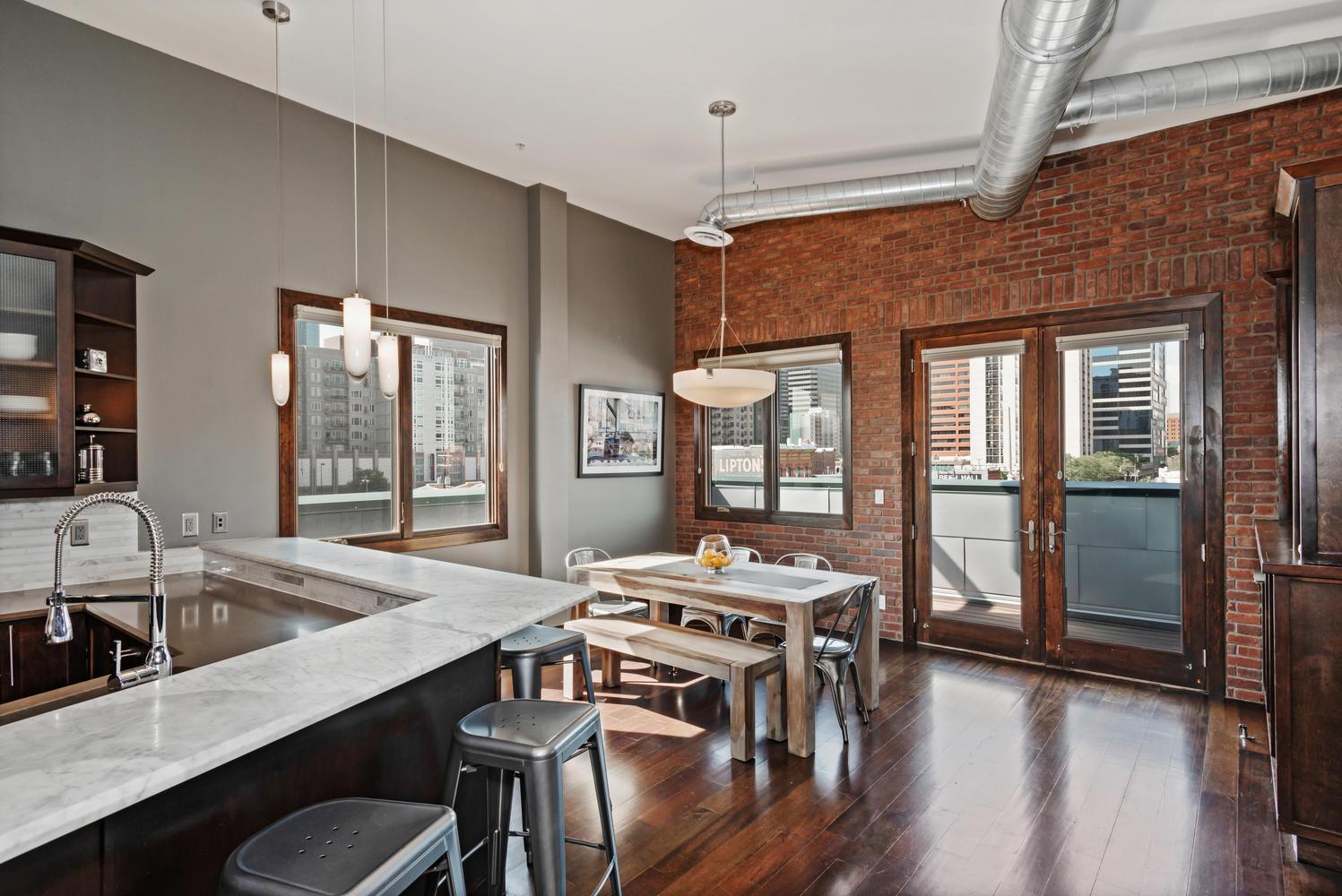 2101 Larimer St Unit 401-large-002-17-Kitchen Dining Room-1497×1000-72dpi