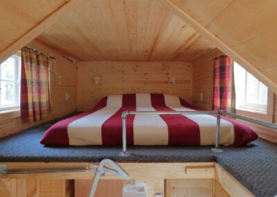New River Tiny House hotel loft of tiny house with queen bed