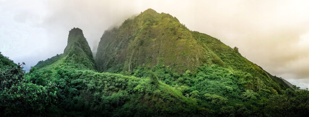 Panorama of the Iao Needle and adjacent mountain in West Maui Mountains at Iao Valley State Park.