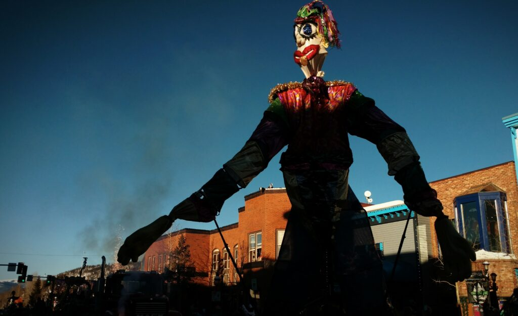 14-foot tall Mardi Gras puppet makes its way down main street during a parade in Breckenridge.