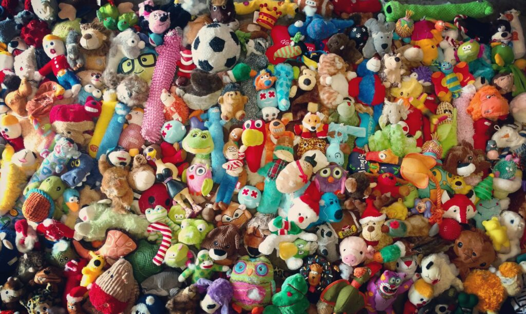 Hundreds of chewed and destroyed stuffed dog toys aligned for a group photo.
