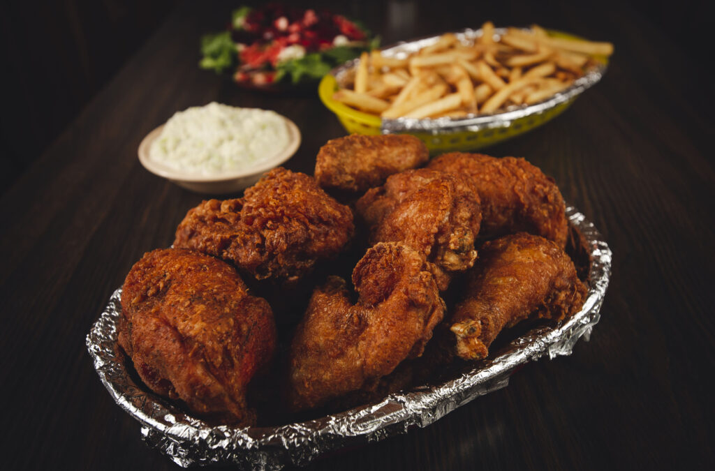Foil-lined basket of fried chicken with sides of cole slaw, french fries and a salad at the Fireside Inn in Enochsburg, Indiana.